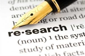 pen pointing to definition research